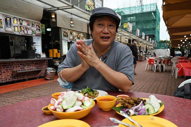 Les hawkers de Singapour: une gastronomie de rue qui risque de disparaître (en images)