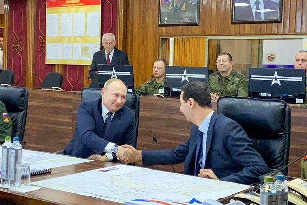 Poetin brengt verrassingsbezoek aan Syrisch president Assad