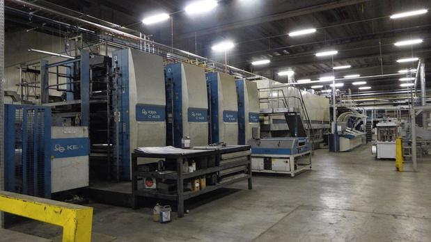 De veiling van de activa van Corelio Printing