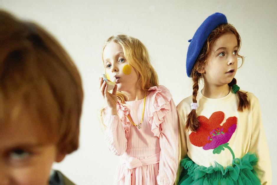 Van felle kleuren tot pompons: feestmode voor de kids