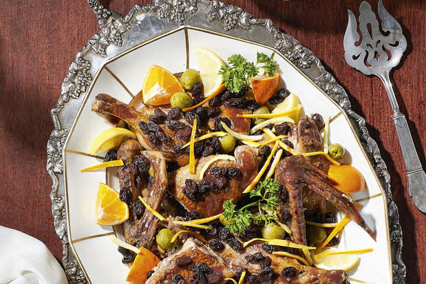 Duck with orange, lemon and olives