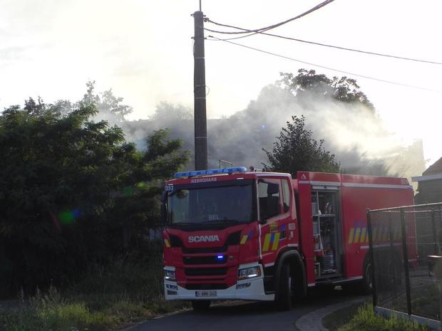 Houtresten vatten vuur bij Copanex in Wielsbeke, rookpluim kilometers ver te zien