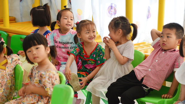 Les couples chinois désormais autorisés à avoir trois enfants