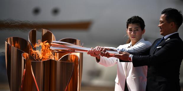 JO Tokyo 2020 : la flamme olympique est arrivée au Japon