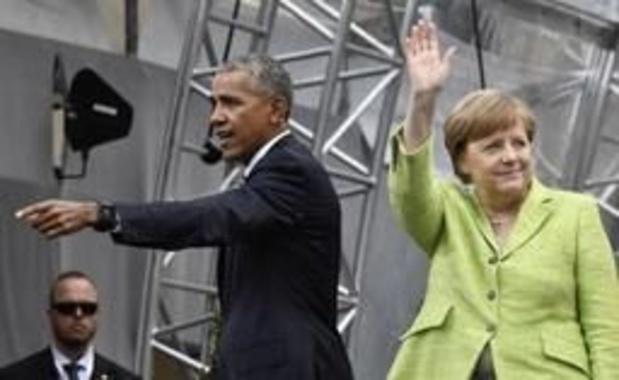 Ex-president Obama, op bezoek bij Merkel, hoopt op ommekeer VS-klimaatbeleid