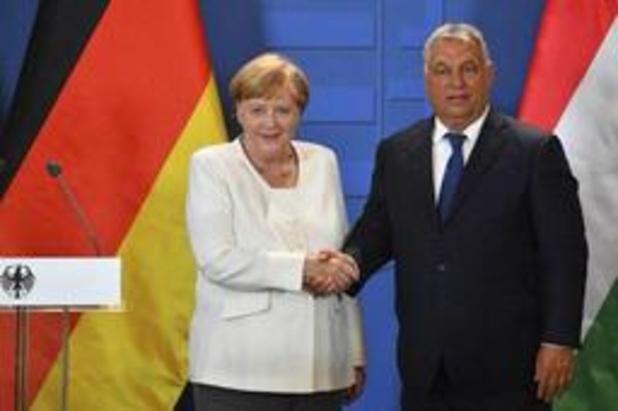 Merkel en Orban herdenken val IJzeren Gordijn