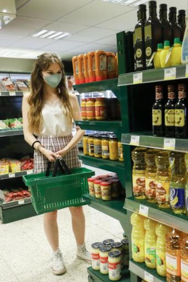 Un nombre croissant de Belges souhaite l'obligation du masque buccal dans les commerces