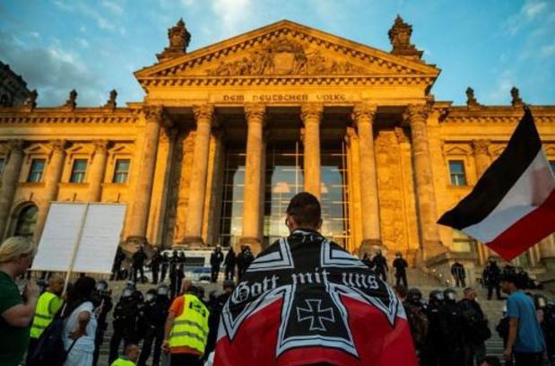 """Allemagne: Merkel dénonce les """"images honteuses"""" de l'incident au Reichstag"""
