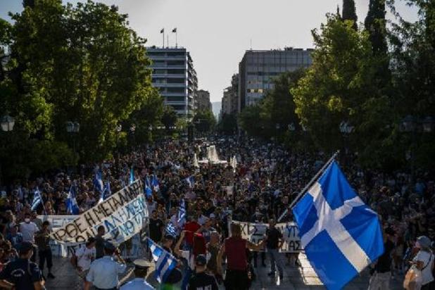 Coronavirus - Duizenden antivaxers op straat in Athene