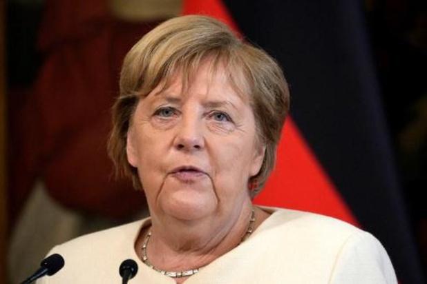 Koning Filip reikt Grootlint in de Leopoldsorde uit aan Angela Merkel