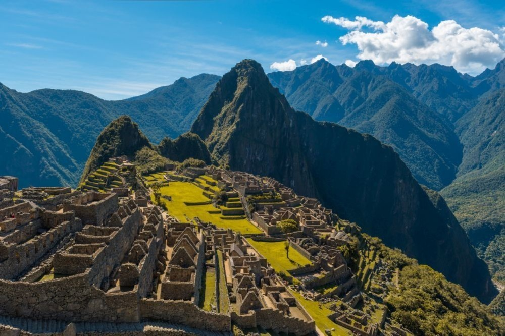 The majestic Machu Picchu during daytime with dry yellow grass in the sacred valley of the Inca, Peru., Getty Images/iStockphoto