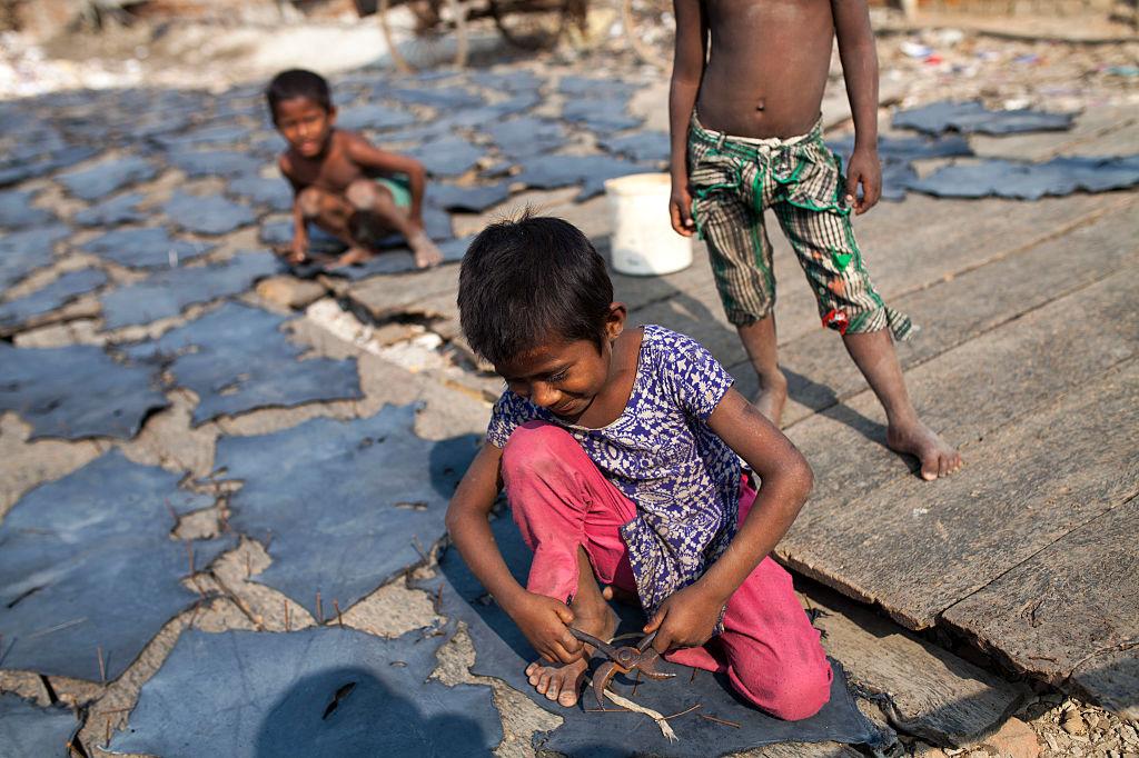 Kinderen in de leerindustrie in Hazaribagh, Getty