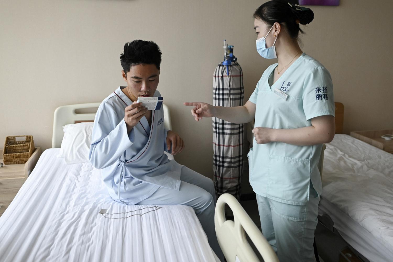 Xia Shurong, au réveil, après son opération, AFP