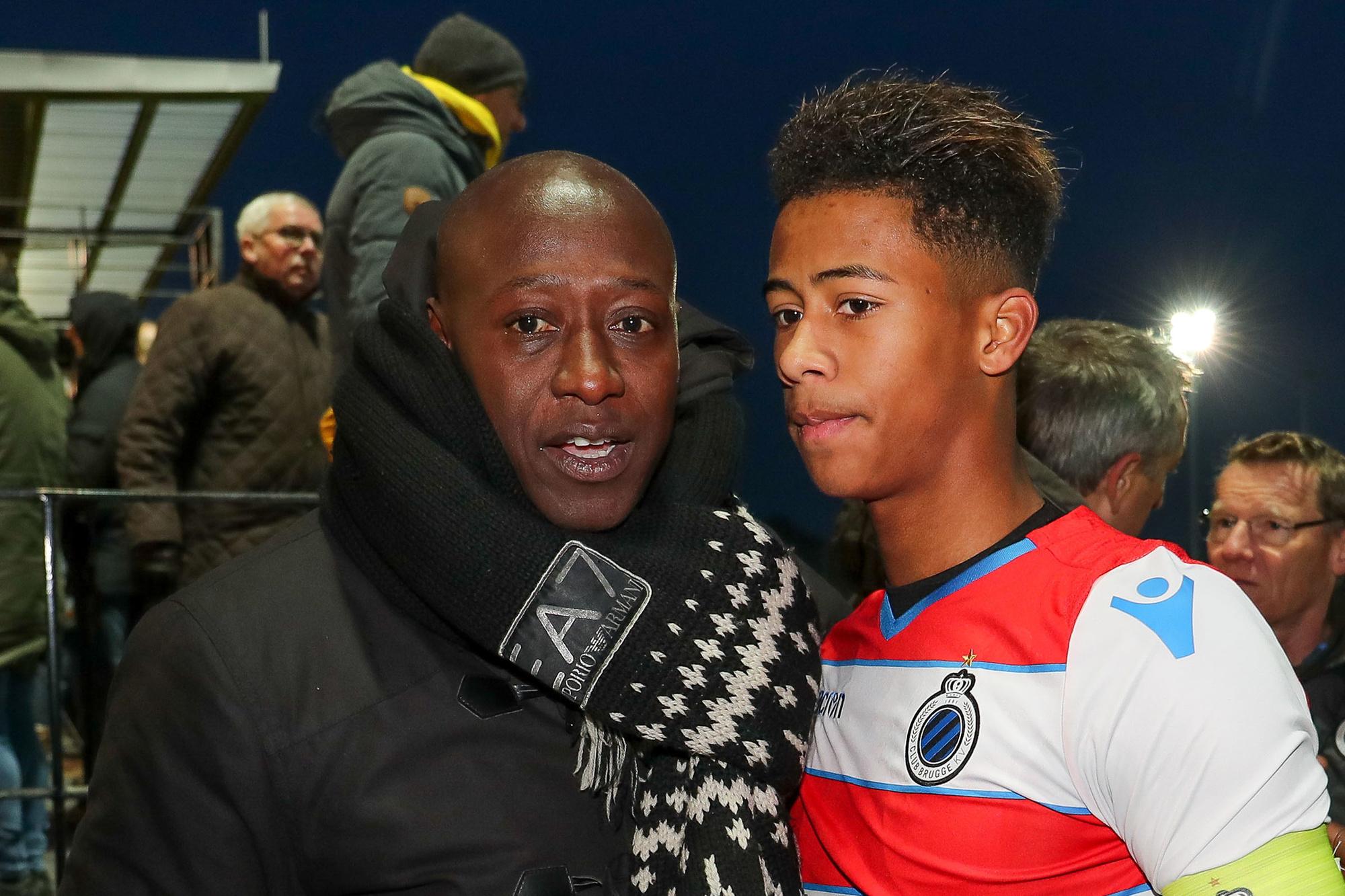 Khalilou Fadiga (links) met zijn zoon Noah Fadiga bij Club Brugge., Belga Image