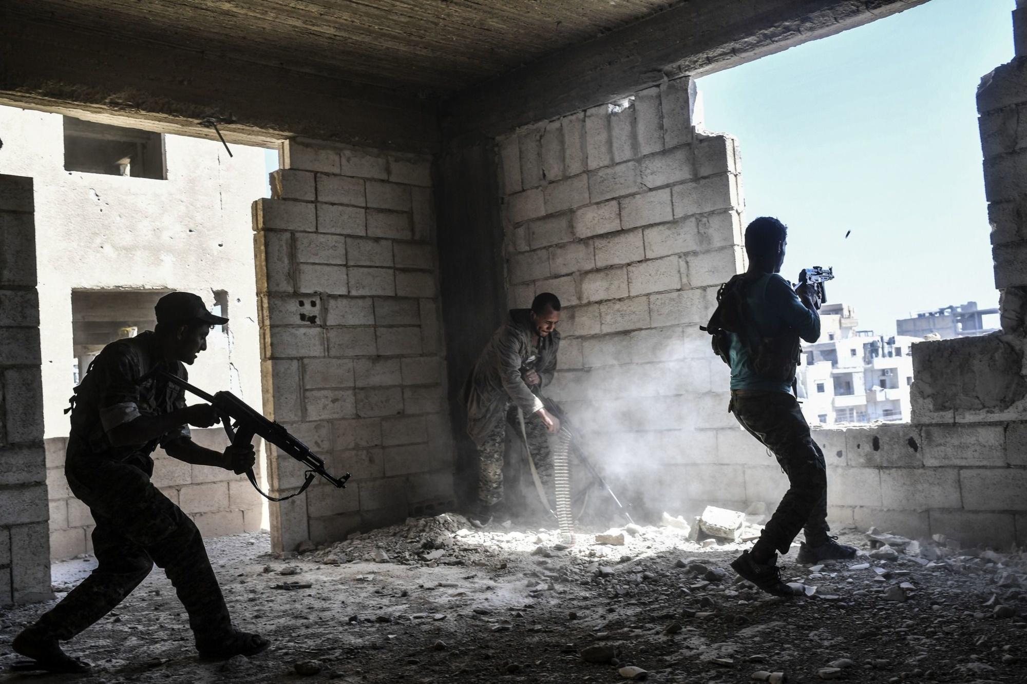 membres des forces du régime syrien à Raqa., AFP