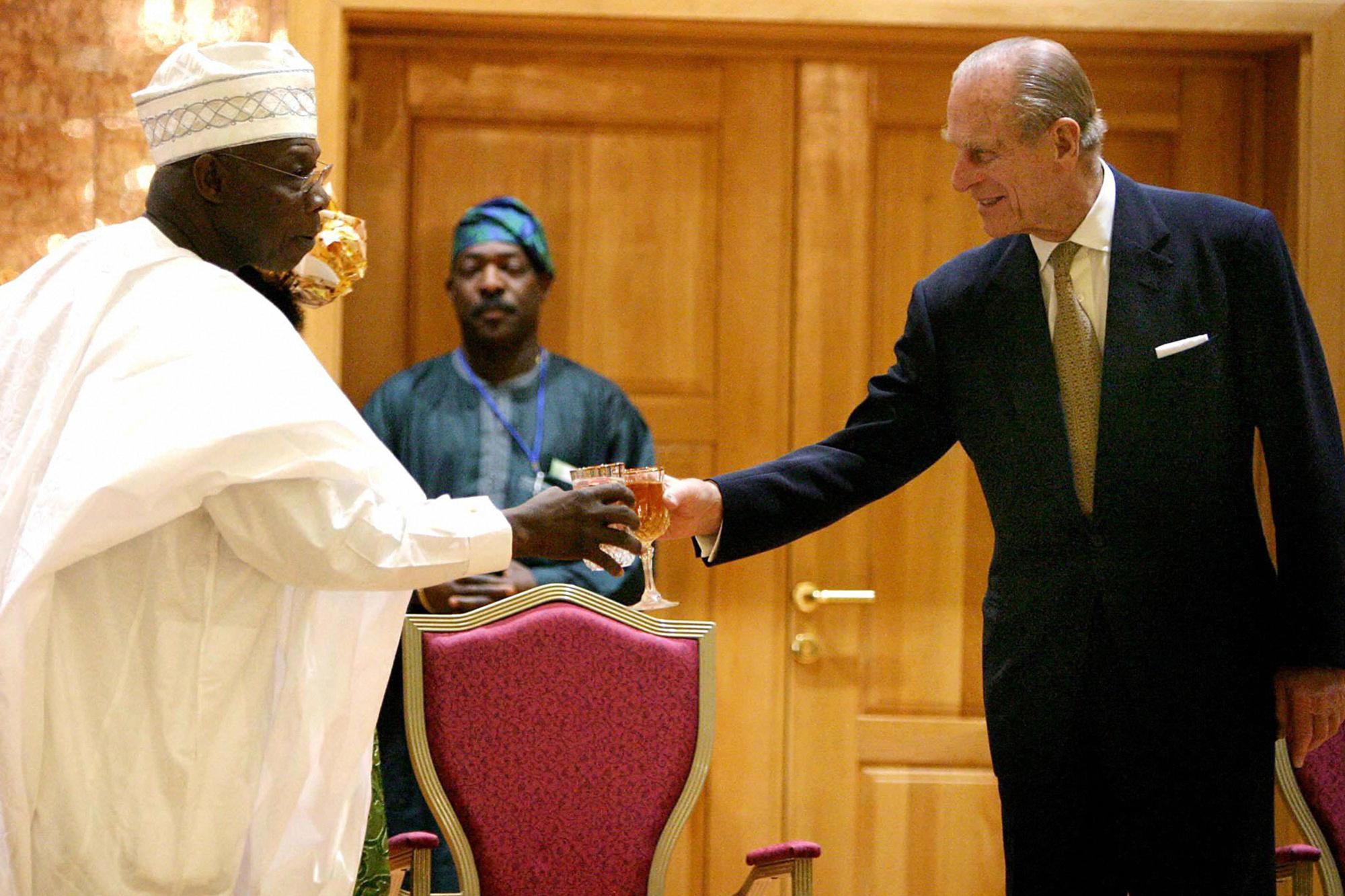 Met de Nigeriaanse president Olusegun Obasanjo in 2003., getty