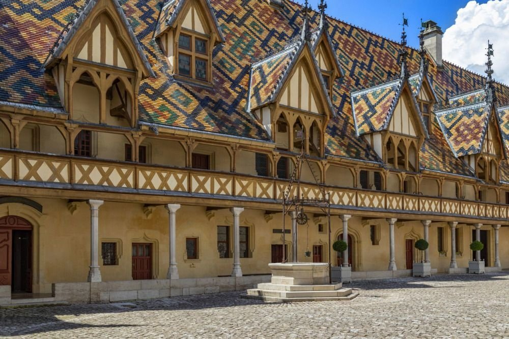 The Hospices de Beaune or Hotel-Dieu de Beaune, a medieval hospital in the town of Beaune in the Burgundy region of eastern France. Founded in 1443, it is a former charitable almshouse., Getty Images