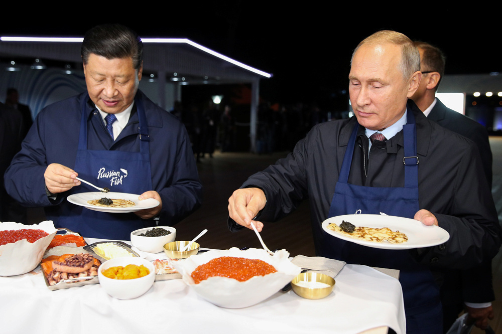 Xi Jinping et Vladimir Poutine, sur le point de passer à table, Reuters
