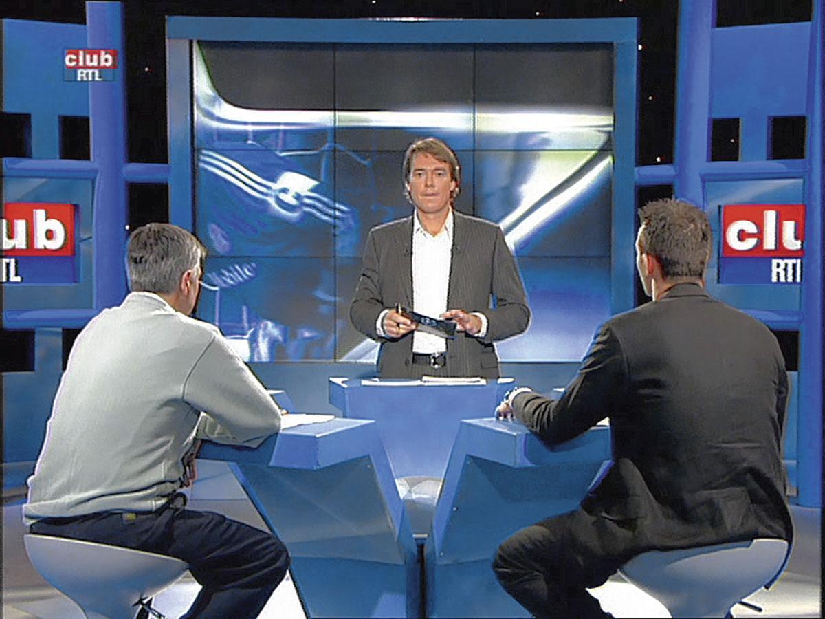 """On a demandé à Georges Grün de """" faire comme Gary Lineker """". Mais c'est plutôt avec Alan Hansen que la ressemblkance est frappante., RTL"""