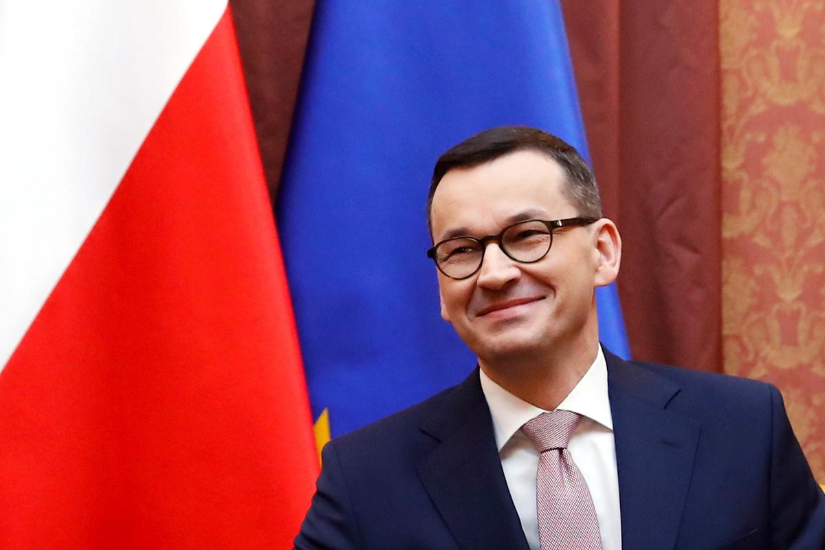De Poolse eerste minister Mateusz Morawiecki. Sinds 2011 is 1 maart een nationale feest- en herdenkingsdag, Reuters
