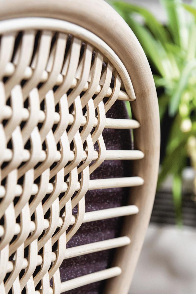 Détail du fauteuil lounge Aya que le designer a créé pour Vincent Sheppard, en collaboration avec des tisserands de rotin en Indonésie., AARON LAPEIRRE