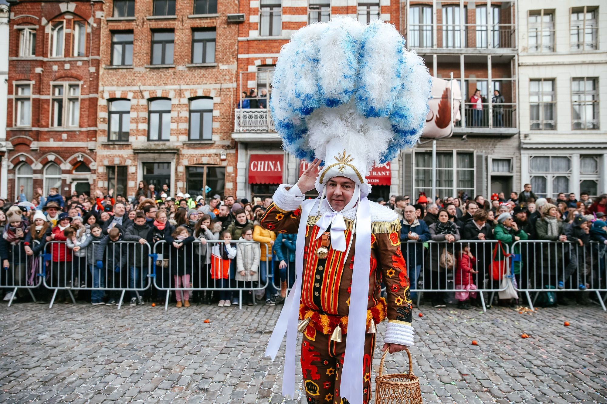 "(190306) -- BINCHE, March 6, 2019 (Xinhua) -- A local resident wearing costume of ""Gille"" attends the parade of Mardi Gras (Shrove Tuesday), the last day of Carnival in Binche, Belgium, March 5, 2019. Binche's three-day carnival, a UNESCO World Heritage event and one of the most famous carnivals in Europe, reached its climax on Tuesday. The Gille costume is a tunic and trousers made of jute decorated with 150 patterns. (Xinhua/Zhang Cheng) , BELGAIMAGE"