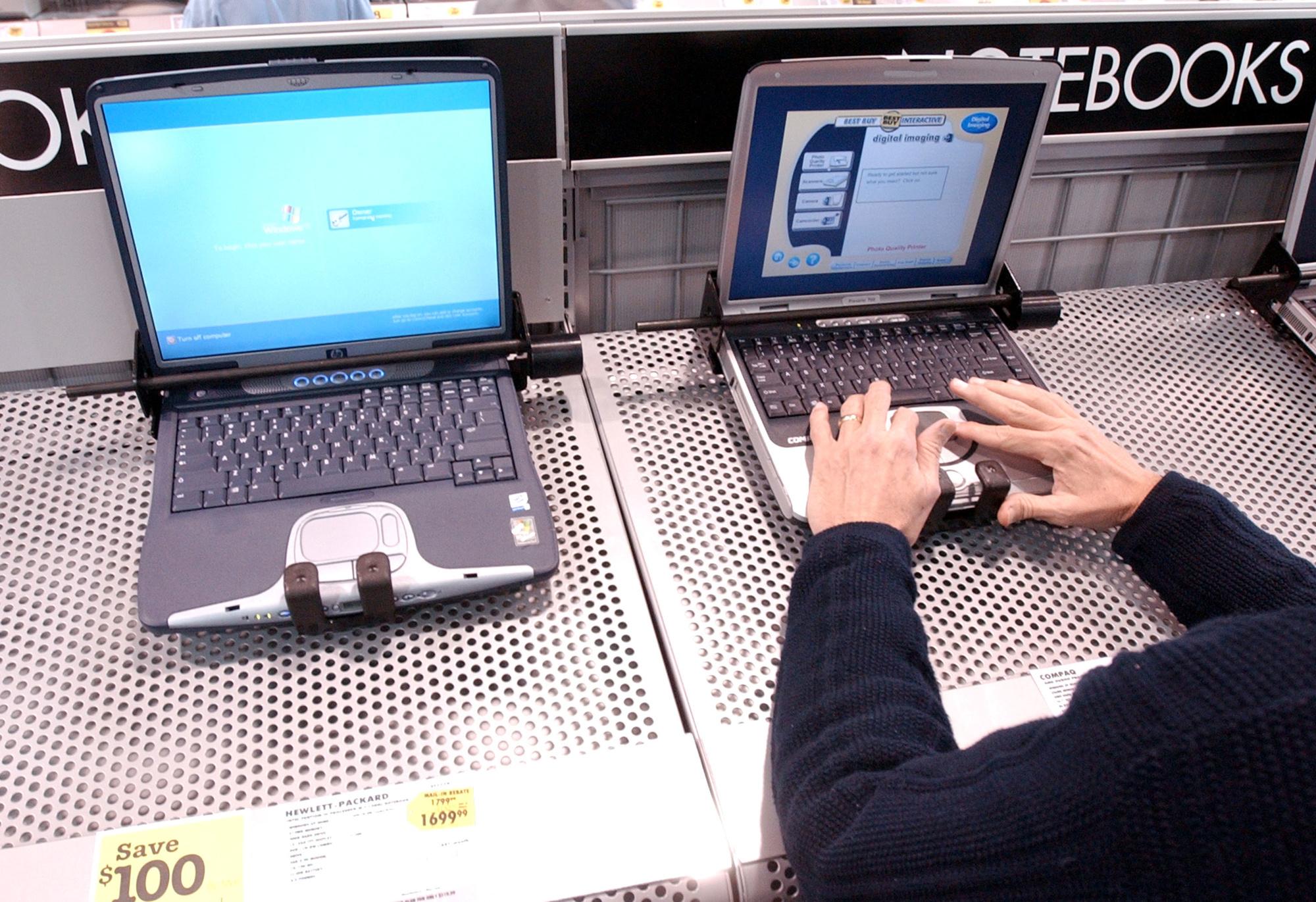 Een laptop van HP en Compaq in 2002., Getty Images